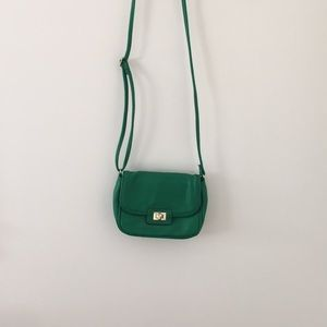 Green crossbody bag with gold details